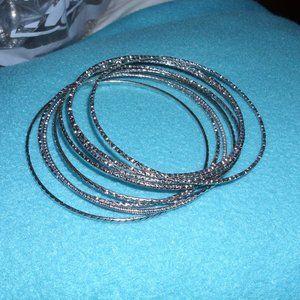 8 silver tone bracelets